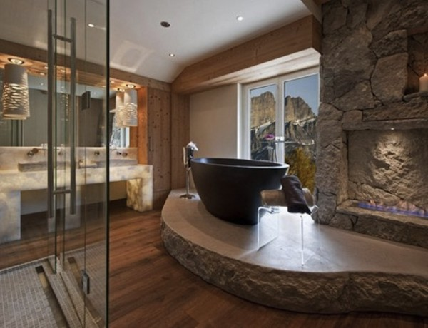 15 Luxury Bathrooms with Astonishing Fireplaces. To see more Luxury Bathroom ideas visit us at www.luxurybathrooms.eu #luxurybathrooms #homedecorideas #bathroomideas @BathroomsLuxury 15 luxury bathrooms with astonishing fireplaces 15 Luxury Bathrooms with Astonishing Fireplaces 15 luxury bathrooms with fireplaces 600x460
